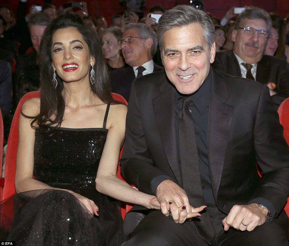 George Clooney and Amal on the red carpet for Hail Caesar Berlin Film Fest premiere 311A520700000578-3442938-image-m-156_1455220235783
