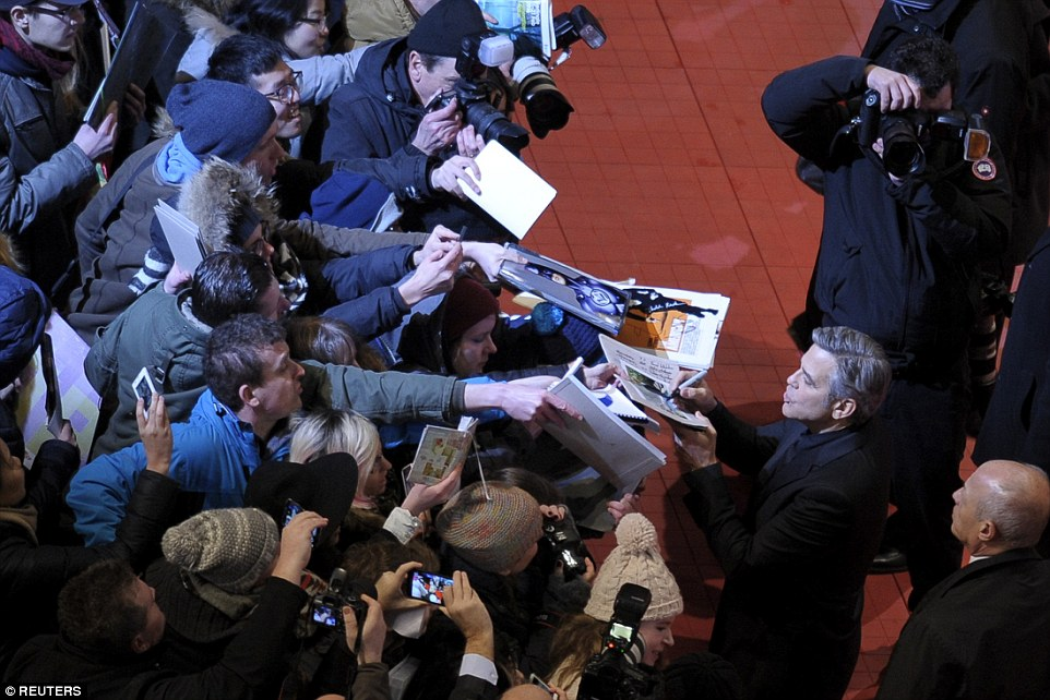 George Clooney and Amal on the red carpet for Hail Caesar Berlin Film Fest premiere 311A12AD00000578-3442938-image-a-2_1455222401706