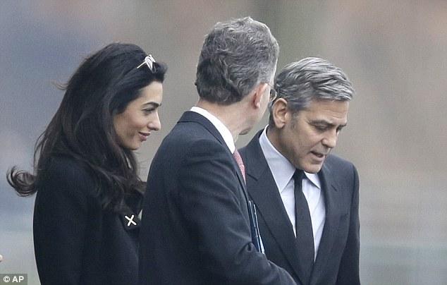 George Clooney to meet with Angela Merkel in Berlin 311F567D00000578-3443821-image-a-12_1455275719540