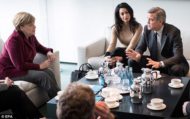 George Clooney to meet with Angela Merkel in Berlin 311F729F00000578-3443821-image-a-8_1455275653122