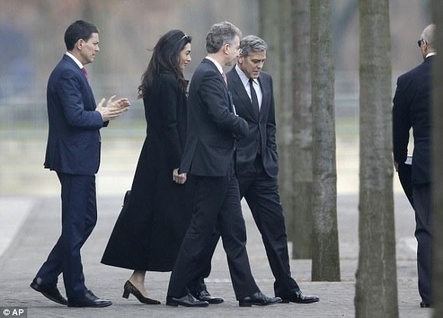 George Clooney to meet with Angela Merkel in Berlin 311F7D6600000578-3443821-image-a-11_1455275708487