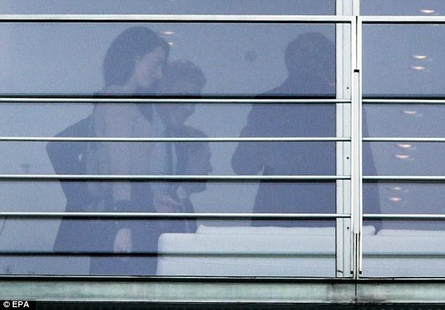 George Clooney to meet with Angela Merkel in Berlin 311FB8C200000578-3443821-image-m-10_1455275663732