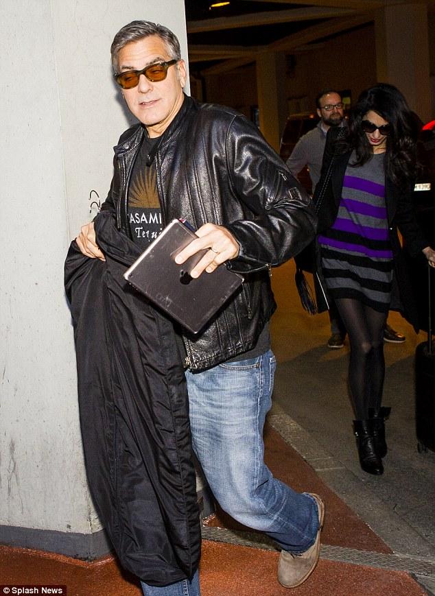 George Clooney and Amal at Berlin Tegel airport leaving Berlin 12.02.2016 312BA07800000578-3445785-image-m-44_1455386904693