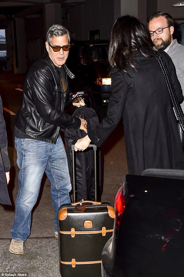 George Clooney and Amal at Berlin Tegel airport leaving Berlin 12.02.2016 312BA38100000578-3445785-image-a-38_1455386798998