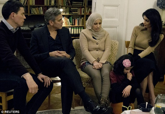 George Clooney and Amal meeting with Refugees 312C72CB00000578-3445796-image-m-18_1455388078051