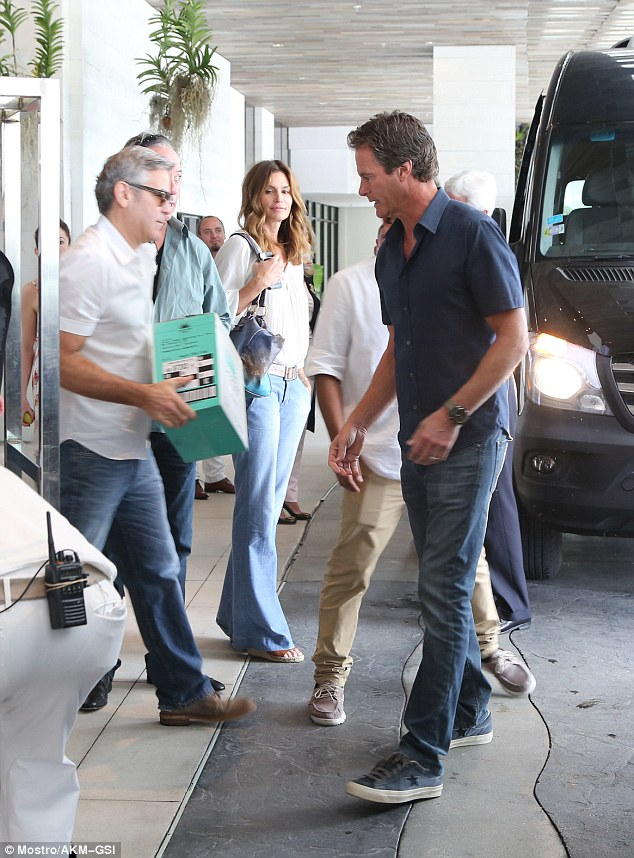 Cindy Crawford waits while husband Rande Gerber and pal George Clooney load car with tequila ahead of her 50th birthday 314B317800000578-3450067-image-a-97_1455659699479
