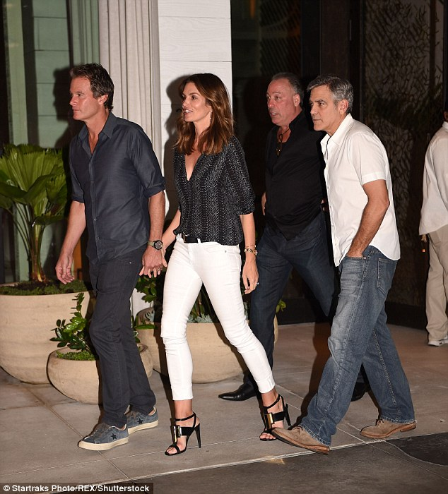 Cindy Crawford waits while husband Rande Gerber and pal George Clooney load car with tequila ahead of her 50th birthday 31497C8D00000578-3450067-image-a-158_1455663323384