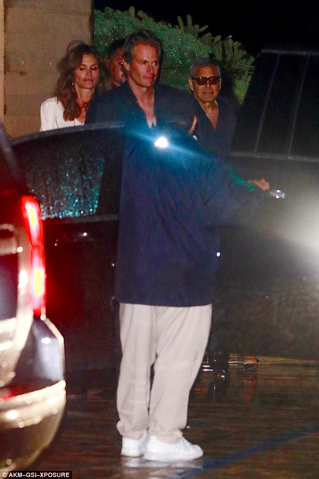 Party of three: George Clooney enjoys a relaxed evening out in Malibu with Cindy Crawford and her husband Rande Gerber 06. March 2016 31E9DA8F00000578-0-image-a-1_1457252503557