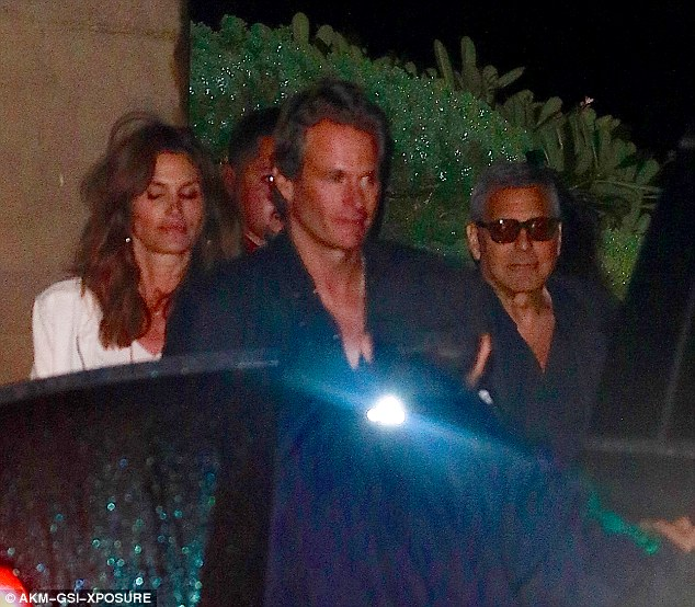 Party of three: George Clooney enjoys a relaxed evening out in Malibu with Cindy Crawford and her husband Rande Gerber 06. March 2016 31E9DAD700000578-3478822-image-a-6_1457254592368