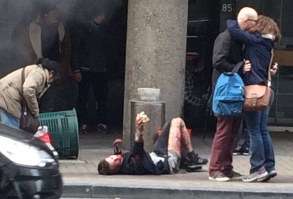 Fake Shootings and Other False Flags - Page 5 3272CE1300000578-3503928-Aftermath_A_man_lies_stricken_on_the_pavement_as_survivors_kiss_-m-10_1458639898628
