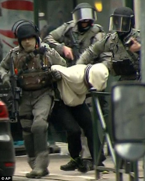 Fake Shootings and Other False Flags - Page 5 32580EA800000578-3503928-Police_officers_bundle_out_a_man_thought_to_be_Abdeslam-a-1_1458654267648