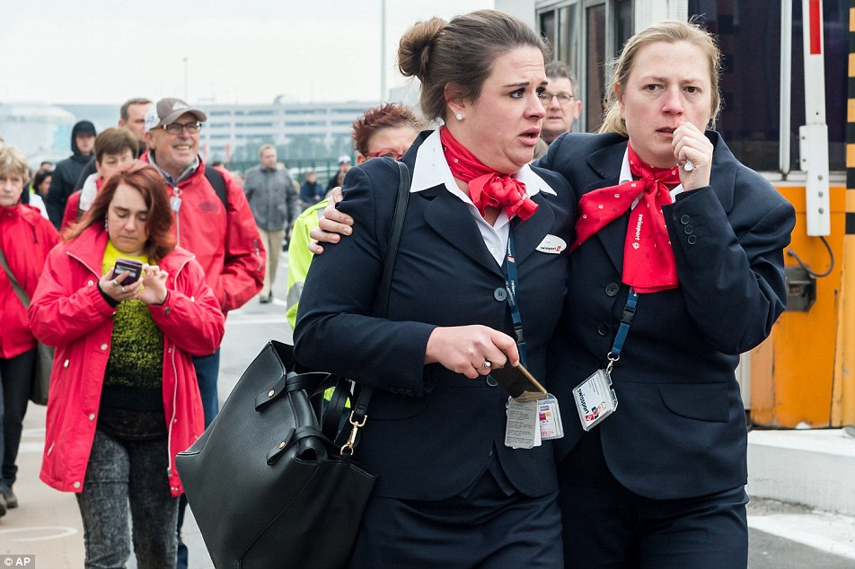 Fake Shootings and Other False Flags - Page 5 3272F41D00000578-3503928-Air_stewardesses_look_shocked_as_they_flee_the_terminal_building-a-60_1458659801709