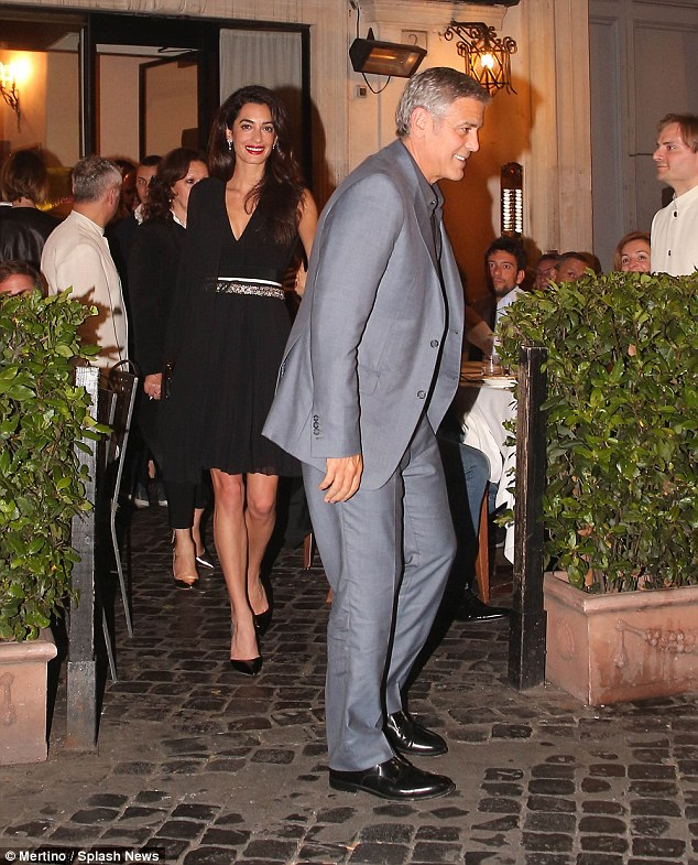 George and Amal out for dinner in Rome May 29 2016 34BE617100000578-3615139-image-m-25_1464532719565