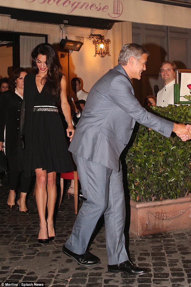 George and Amal out for dinner in Rome May 29 2016 34BE622800000578-3615139-image-a-22_1464532629138