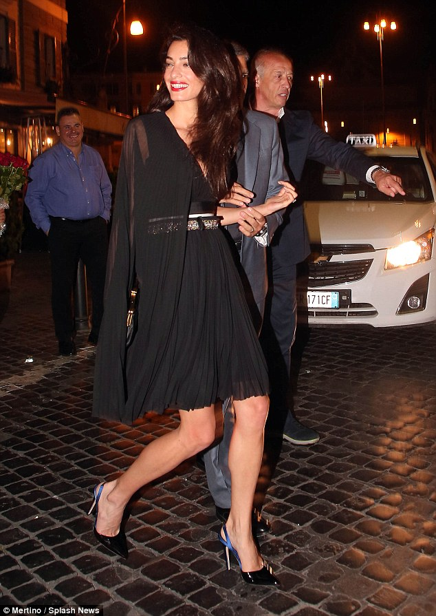 George and Amal out for dinner in Rome May 29 2016 34BE631900000578-3615139-image-m-29_1464532758604