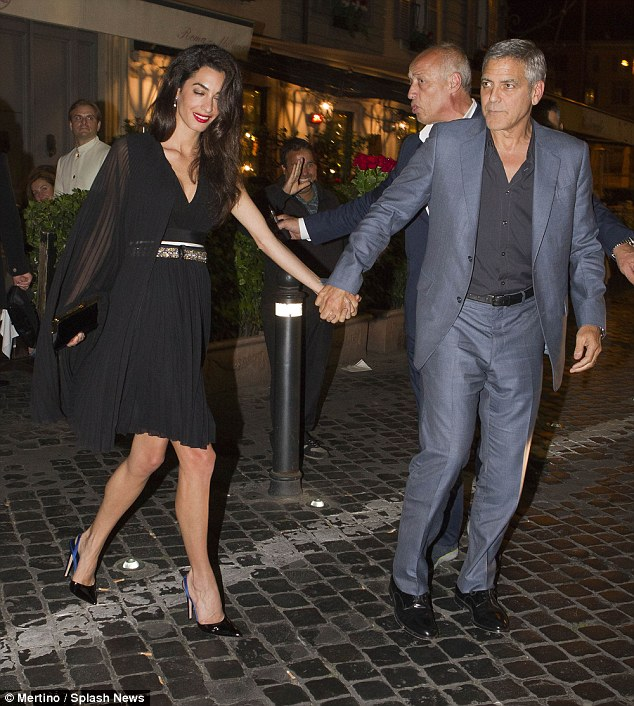George and Amal out for dinner in Rome May 29 2016 34BE672A00000578-3615139-image-m-31_1464532775417
