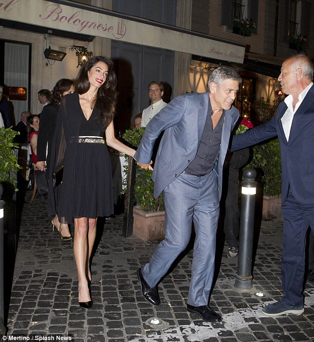 George and Amal out for dinner in Rome May 29 2016 34BE677900000578-3615139-image-m-27_1464532739494