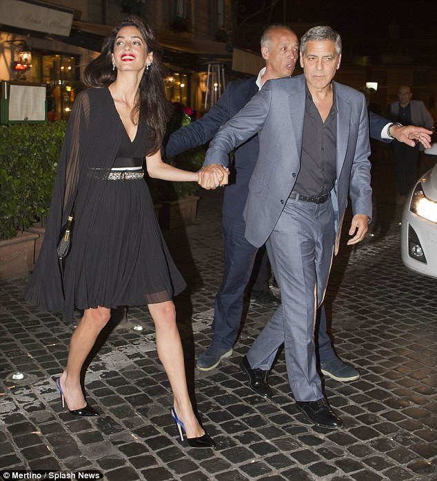 George and Amal out for dinner in Rome May 29 2016 34BE67A900000578-3615139-image-m-28_1464532750099