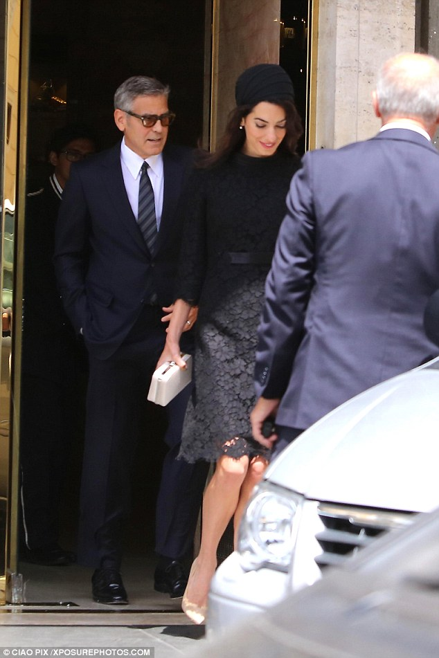 George and Amal out for dinner in Rome May 29 2016 34BF297200000578-3615139-image-a-35_1464533870141