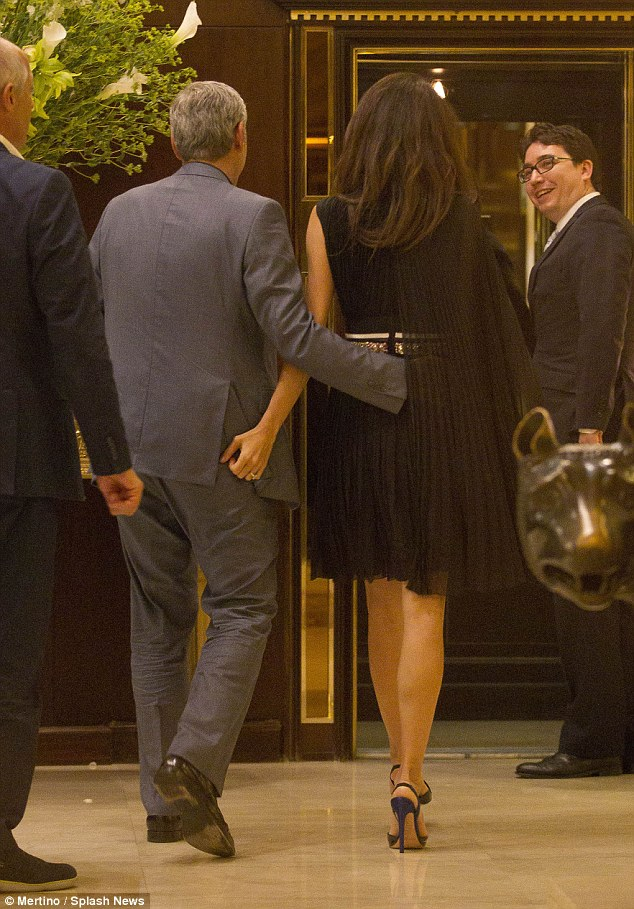 George and Amal out for dinner in Rome May 29 2016 34BE684200000578-3615139-What_a_gentleman_The_loving_duo_were_spotted_walking_in_to_the_h-m-84_1464538097982