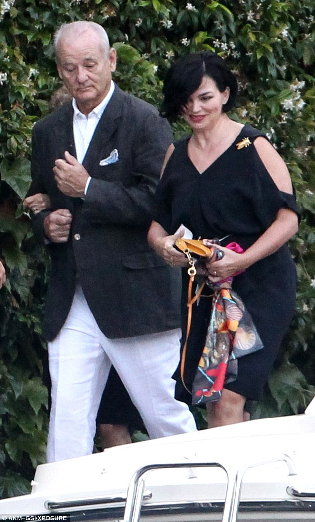 George and Amal, friends and family on way to dinner at Villa D'eEste 36369EE600000578-0-image-m-118_1468381398261