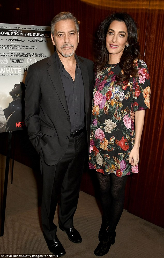 George and Amal Clooney in London 9.1.17 3C02F5DC00000578-4104636-Important_issue_The_couple_were_supporting_Netflix_movie_The_Whi-a-27_1484036487247