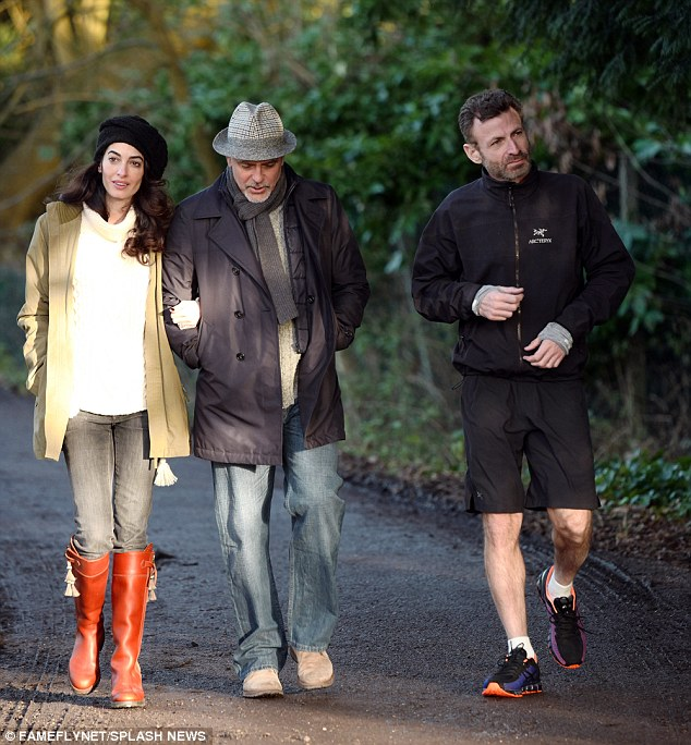 George and Amal out for a walk 3C0DAEA800000578-4110338-image-m-13_1484156519532