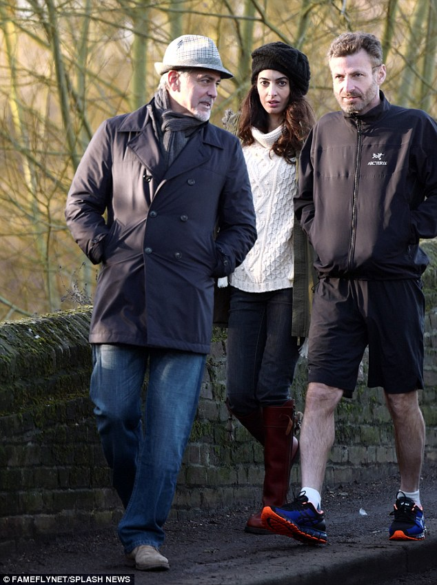 George and Amal out for a walk 3C0DAF6900000578-4110338-image-m-22_1484156749169