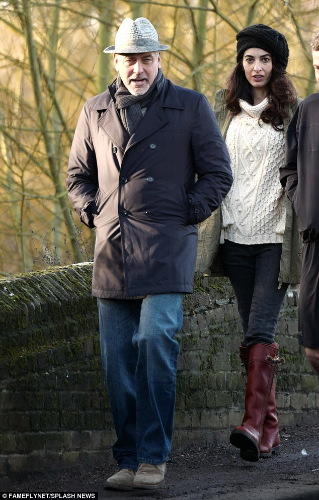 George and Amal out for a walk 3C0DB18D00000578-4110338-image-a-23_1484156782006
