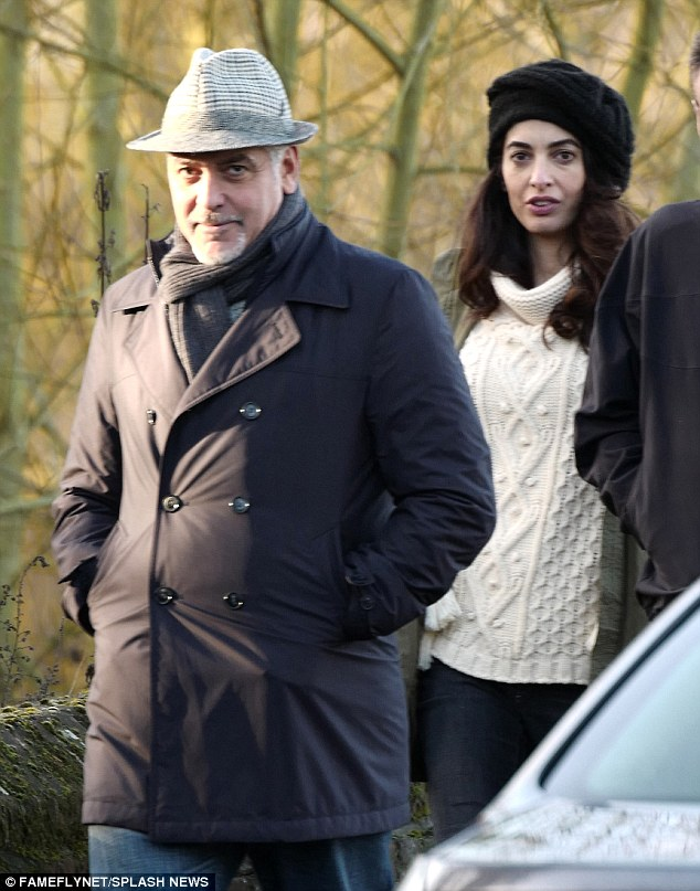 George and Amal out for a walk 3C0DB19700000578-4110338-image-a-10_1484156398223