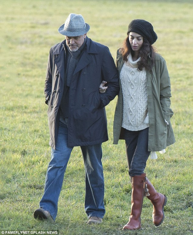 George and Amal out for a walk 3C0DB41800000578-0-image-a-1_1484155086582