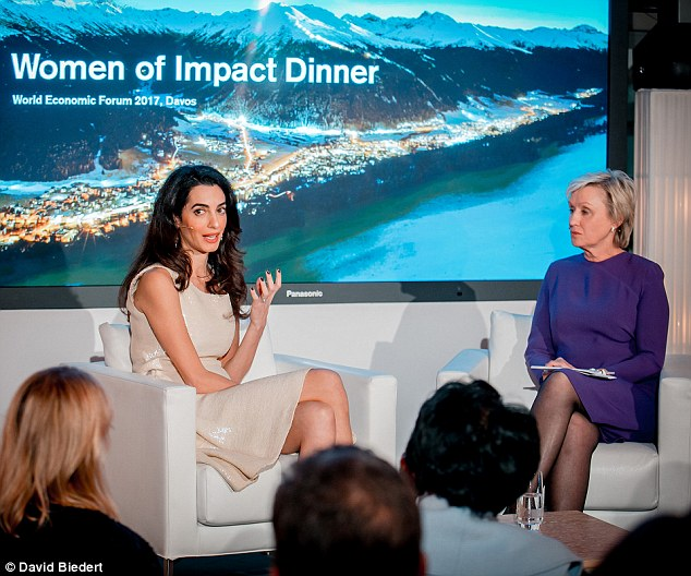 george and amal clooney in davos world economic forum Jan 2017 3C3A754200000578-0-Sharing_her_opinions_Amal_was_one_of_those_invited_to_speak_at_t-m-118_1484724582211