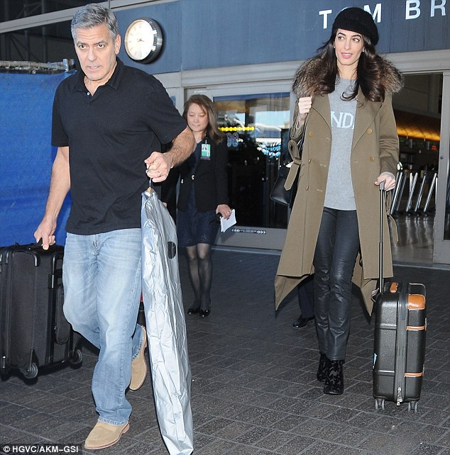 George and Amal arrive at LAX today -  3C94A21000000578-4165830-Back_in_the_states_Amal_Clooney_stepped_out_wearing_a_baggy_swea-a-96_1485562257290