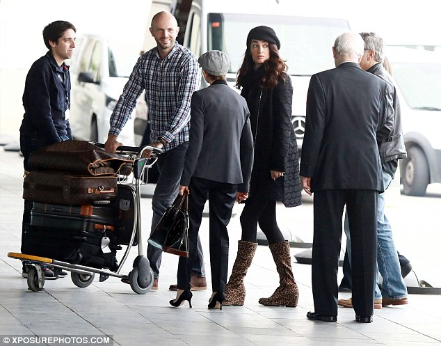 George and Amal Clooney leave Spain 3CCD609B00000578-4188588-image-m-48_1486143086728