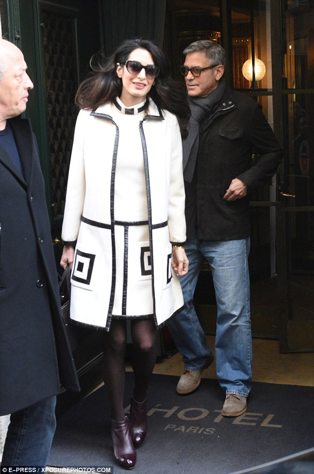 George and Amal Clooney go for a walk 3DA7282B00000578-0-image-a-21_1488035318347