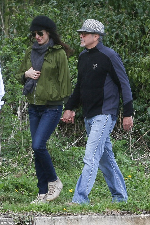 George and Amal out for a walk 3ED5486A00000578-4371194-image-a-55_1491061253777