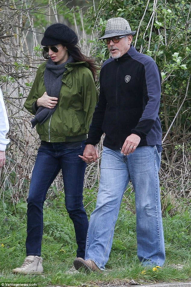 George and Amal out for a walk 3ED549A200000578-4371194-image-a-61_1491061305528