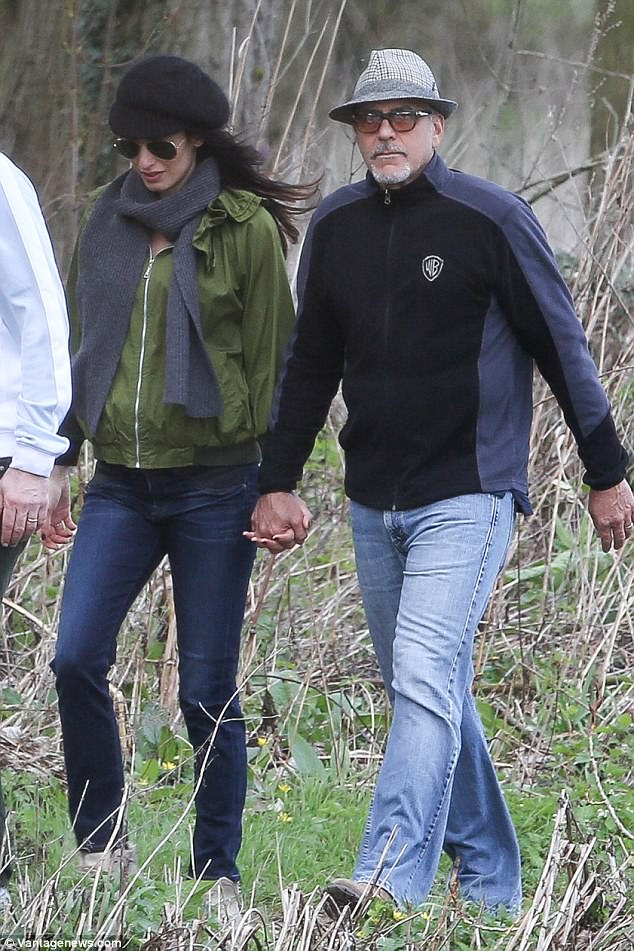 George and Amal out for a walk 3ED549D200000578-4371194-image-a-56_1491061271345