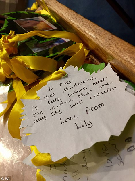 Mccanns join villagers at church today 3FE79F3600000578-4470752-A_tribute_from_a_young_girl_named_Lily_is_left_at_the_church_ahe-a-48_1493843654043