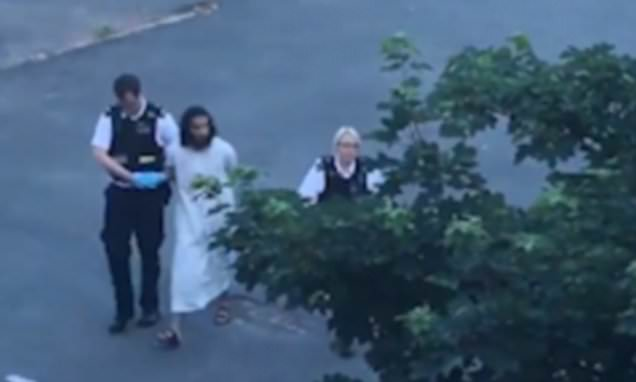 The moment a robed man wearing sandals is arrested 4150E95500000578-0-image-a-57_1497125685893