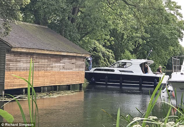 George's boat house hit by a motor yacht 417CB60C00000578-4613198-image-a-3_1497695651301