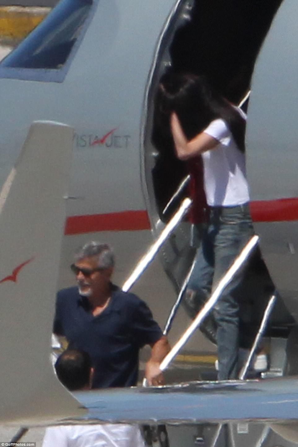 George and Amal Clooney Step Out for the First Time with Newborn Twins During Family Trip to Italy 421D433800000578-4674800-Casually_cool_Amal_39_dressed_her_svelte_frame_in_a_crisp_white_-a-130_1499432633401