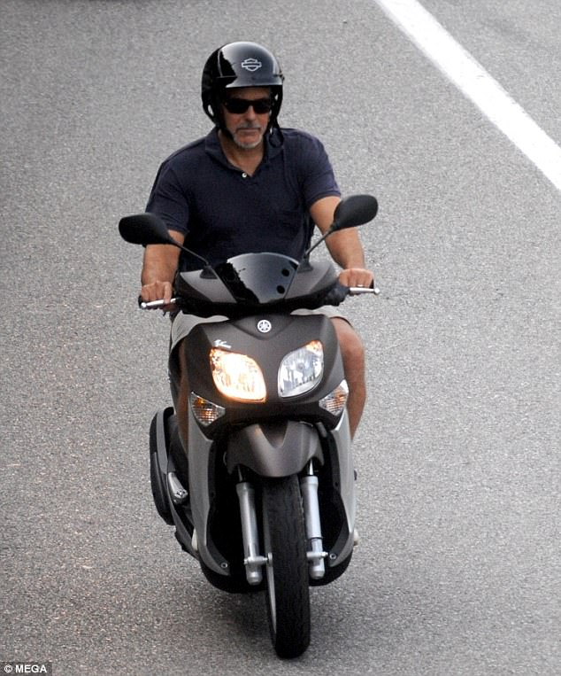Parenthood's a bumpy ride! New dad George Clooney whizzes around on his scooter in Lake Como as he holidays with wife Amal and their baby twins 424BC71200000578-0-image-a-82_1499960035778