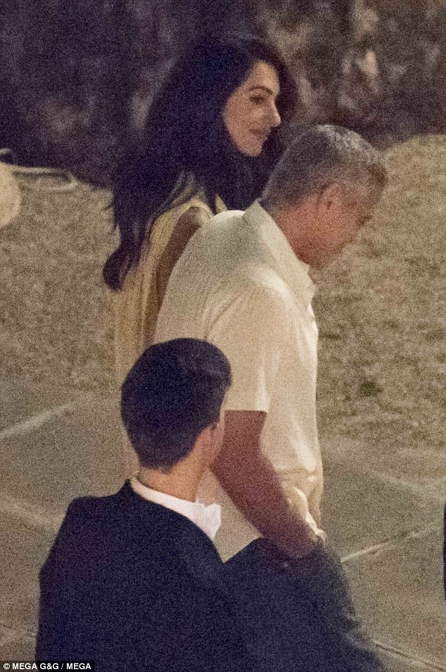 George Clooney is back in Como 4278352D00000578-4710124-Amal_Clooney_wore_a_floaty_yellow_dress_as_she_held_hands_with_h-a-38_1500457729554