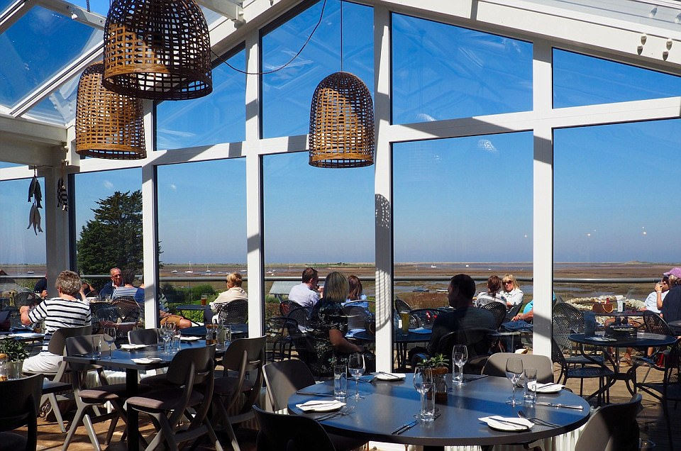 Are these the best tables in Britain? The most stunning restaurant views in the country revealed (from dramatic cityscapes to awe-inspiring Highland mountains)  430D3BCA00000578-4768316-The_White_Horse_restaurant_on_the_Norfolk_coastline_has_full_gla-a-28_1502615861585