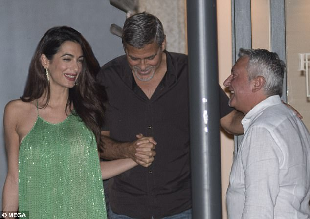 George and Amal out and about at Harry's Bar in Cernobbio 436C4A0300000578-4808394-Happy_Smitten_Amal_was_beaming_from_ear_to_ear_as_she_clutched_o-a-11_1503386440680