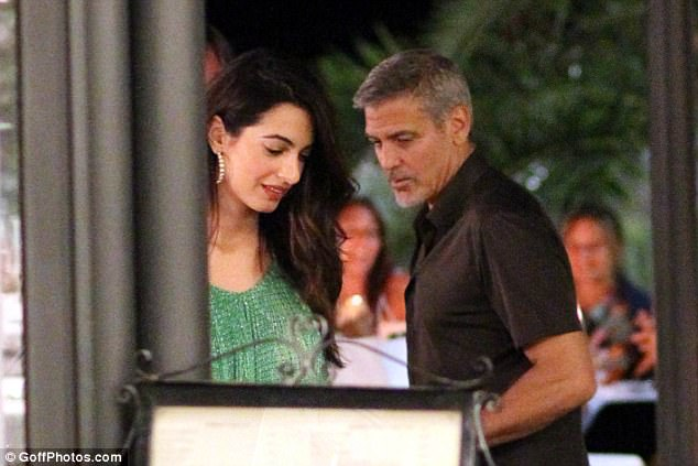George and Amal out and about at Harry's Bar in Cernobbio 436E08D500000578-4808394-At_ease_The_smitten_couple_were_seen_emerging_from_the_restauran-a-6_1503386440335