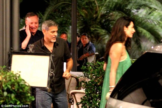 George and Amal out and about at Harry's Bar in Cernobbio 436E0B4700000578-4808394-A_list_duo_The_couple_are_currently_holidaying_in_Italy_with_the-a-8_1503386440406