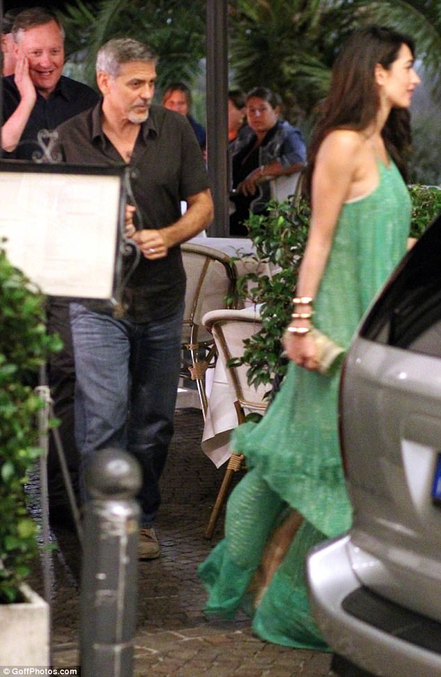 George and Amal out and about at Harry's Bar in Cernobbio 436E0B5900000578-4808394-Casual_George_meanwhile_cut_a_dapper_figure_in_a_low_key_ensembl-a-7_1503386440405