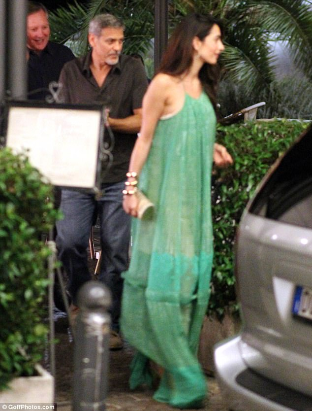 George and Amal out and about at Harry's Bar in Cernobbio 436E0B6100000578-4808394-Gorgeous_Amal_s_stunning_semi_sheer_number_billowed_out_around_h-a-1_1503386439873